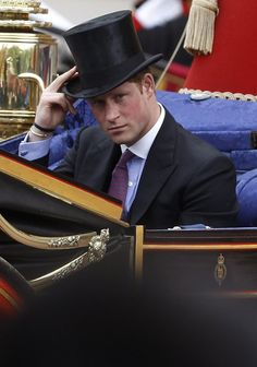 Prince Harry travels in a horse-drawn carriage procession to Buckingham Palace through central London