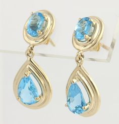Swiss Blue Topaz Drop Earrings 14k Yellow Gold A Great Big Welcome! To #WilsonBrothers Now available in our #etsyshop http://www.howtodiywedding.com #stationary #estatejewelry #vintagejewelry #wedding #vendor #etsy #etsywedding #diy  #diywedding