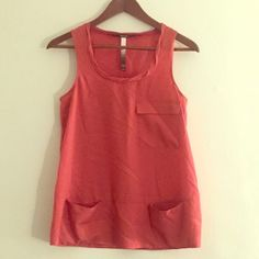 Kensie dress top with pockets Darker shade of orange with two lower pockets and one on top that are all proper pockets (not fake). Great for work and play! Kensie Tops