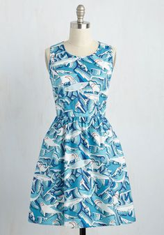Craft an ensemble for the record books around this awe-inspiring shark dress! Delivering memorable detail in its back keyhole cutout, dual hip pockets, and blue and white print of sea scarers, this cotton look makes others 'sail' in comparison.