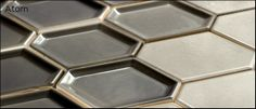 Nemo Tile!  Will make the perfect backsplash in white or an undulating gradient of grey....