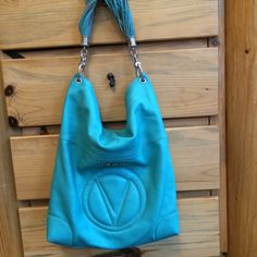 Valentino Bags by Mario Valentino Cavino Valentino pristine condition, turquoise leather, absolutely gorgeous. Made in Italy. This is the big boy.            Measurements Bottom Width: 14 in Depth: 3 1⁄2 in Height: 18 in Strap Length: 21 in Strap Drop: 9 1⁄2 in Weight: 1 lb 12.4 oz Valentino Bags Shoulder Bags