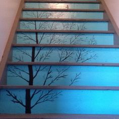 Stairs painted with a tree and birds