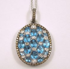 5.04 Carats of Blue Topaz & White Diamonds set in an 18k White Gold Oval Shaped Pendant with a Halo of Cocoa Diamonds on a White Gold Chain. - $2,750