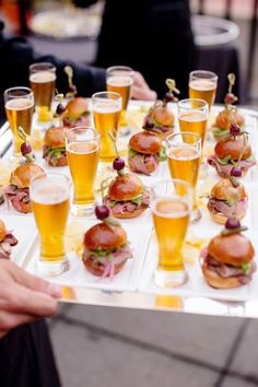 Cocktail hour idea - mini beer steins and sliders ~ http://www.brides.com/blogs/aisle-say/2015/05/creative-wedding-food-pairings.html
