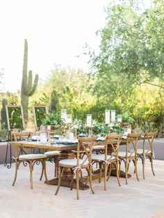 Wooden wedding table with greenery and succulents: Photography: Elyse Hall Photography  - www.elysehall.com   Read More on SMP: http://www.stylemepretty.com/2017/02/22/pantone-color-year-2017-greenery-inspired-styled-wedding-shoot/