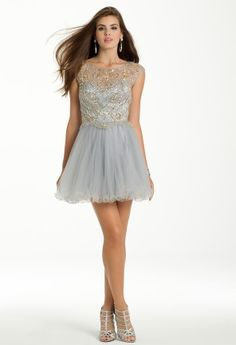 Mock two piece dress with beaded illusion cap sleeves and tulle wire hem skirt by Dave and Johnny.<br><br>��Boat neckline<br>��Bead and illusion bodice<br>��Tulle wire hem skirt<br>��Key hole back with single top closure<br>