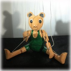 Hand carved bear marionette puppet estimate to be from the 1930s. Folk art puppet is all wood. Hand carved and hand painted.    Item: Marionette