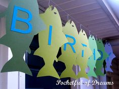 could do this..cutting fish out of craft foam and make garland for awning...choose different color.