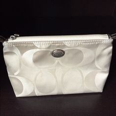 Coach accessory pouch Authentic Coach zipper pouch to hold purse essentials or makeup. Light discoloration mark as shown in second photo. Priced for this flaw. Coach Bags Cosmetic Bags & Cases