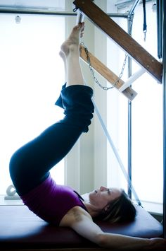 """One of my favorites Pilates exercises - """"tower"""" on the Cadillac. Great for spine, abdominals, gluteus, hamstrings, feet, and ankles. All that and it's relaxing, oddly. :)"""