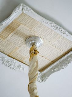 Create a ceiling medallion by painting an old frame white. Next, layer pages of sheet music and glue to the frame back. Cut a hole in the frame back for the wires and chandelier chain to pass through. Secure the frame to the ceiling with a strong glue. Decor, Flea Market Style, Cottage Style, Pretty House, Flea Market Finds Repurposed, Diy Ceiling, Old Picture Frames, Do It Yourself Decorating, Ceiling Medallions