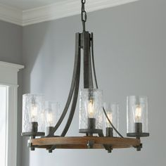 Make a farmhouse style statement with this industrial farmhouse chandelier. The rustic thick metal bars of the circular frame are finished in a rich, textured Slate Gray and add a stately weight to the Distressed Weathered Oak metal base. Gorgeous thick wavy glass shades pull the look together. This chandelier is a beautiful addition to kitchen islands, foyers, and above dining room tables. Farmhouse Dining Room Lighting, Industrial Farmhouse Decor, Dining Room Light Fixtures, Kitchen Chandelier, Dining Lighting, Rustic Lighting, Glass Chandelier, Dining Room Table, Rustic Farmhouse