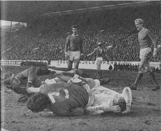 14th March 1970. Mick Jones is left dazed after clashing with Manchester United duo Alex Stepney and Tony Dunne in an FA Cup Semi Final tie.