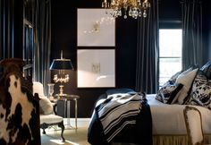 Love the scale of the large frames to the small print.  Drooling over the rich navy bedroom too!