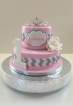 Vertical chevron and pink super girly first birthday cake for a princess