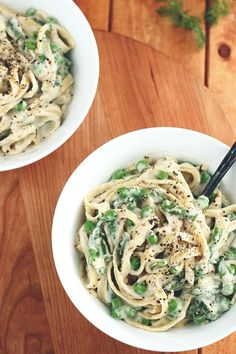"""Vegan Garlic Alfredo with Peas & Asparagus. The """"Alfredo sauce"""" is ridiculously delicious – it's flavorful, light and velvety. It's made from tender boiled cauliflower, plenty of sautéed garlic, nutritional yeast, vegetable broth, Silk Unsweetened Original Almondmilk, salt and pepper. Pretty simple!"""