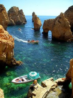 Lagos, Portugal  I have actually been along this coast with these majestic rock formations and arcs .... lost my camera in the water there also!!  :oO