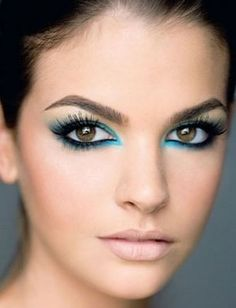 Add depth to your look by shading around your black eye liner with a pretty blue.