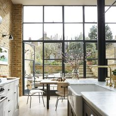 A little bit industrial, a little bit English country, this Victorian south London home has exposed brick walls, Crittall doors and a country kitchen. Metal Windows, Floor To Ceiling Windows, Black Windows, Industrial Windows And Doors, Large Windows, Crittal Doors, Crittall Windows, Conservatory Kitchen, Glass Extension