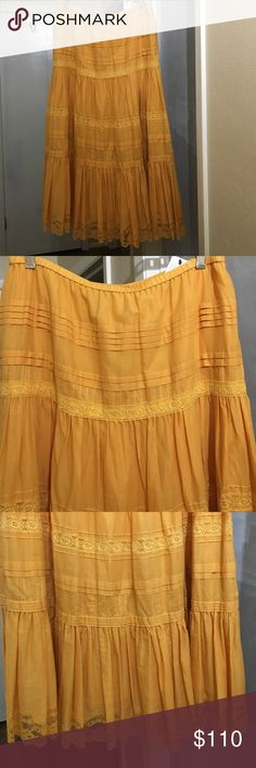 """DKNY Women's peasant style skirt Women's DKNY NWT peasant style full flowing skirt. The tags call the color """"nectar"""". It's a orangish yellowish gold color. It's 100% cotton exterior/100% silk lining/100% nylon lace. Purchased at Nieman Marcus. It's a beautiful skirt but I didn't return it in time. Oops 🙊. My loss your gain. DKNY Skirts"""