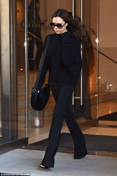 Back to basics: Victoria Beckham lived up to her chic reputation once again on Thursday as she left her New York City hotel clad in yet another stylish ensemble