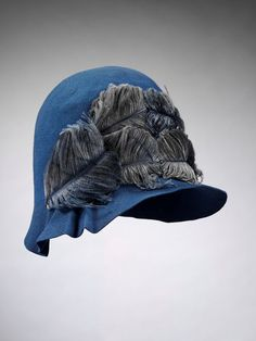 Cloche hat of felt trimmed with ostrich feathers, made for Liberty and Co. Ltd, London, Cloche hat of mid-blue felt trimmed with mid-blue ostrich feathers. Lined with fine cream silk taffeta with a drawstring adjustment. Felt and ostrich feathers, l Vintage Outfits, Vintage Fashion, 20s Fashion, Victorian Fashion, Vintage Dresses, Image Mode, 1920s Hats, Mode Vintage, Fascinators