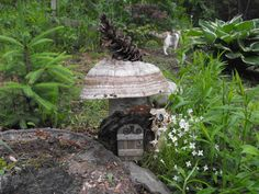 """birch """"log"""" house Wee Folk-Faerie garden decor.  genuine birch log adorned with mushroom & pine cone for roof. a door attached along with wire sign hanger"""