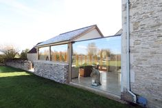 Green barn is a structural glass link between a traditional cottage and new glazed conservatory, which includes solar control coatings. This is an IQ Glass project, and was installed by IQ Specialist Works. Glass Walkway, Architecture Design, Cottage Extension, Green Barn, Glass Extension, Glass Structure, House Extensions, Rose Cottage, Modern Glass