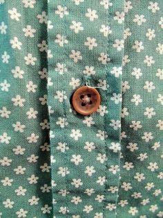brown button green shirt