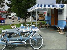 The outdoors and wonderful trailer living or vacationing with picnic table and bike, the works.