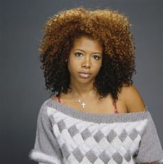 The curls, the color, the height, the definition. Kelis is my hair icon.