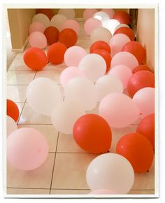 floor full of red white and pink balloons on Valentine's morning