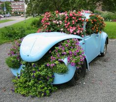 The magic of a Volkswagen, Most of us have owned or ridden in one, some have created fond memories in a VW. We learned how to drive in them ,we stuffed lots of people in them, made dune buggies out of them.  But what do you do with the leftover Volkswagen's? We found some creative garden art to share with you. Remember no matter what we have to work with in our life we can always make it beautiful.