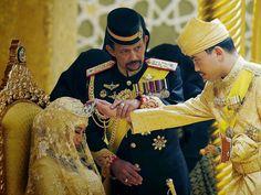 The newly-wedsPrince Abdul Malik and Dayangku Raabi'atul 'Adawiyyah Pengiran Haji Bolkiah are seen walking in the Throne Hall in their mat...