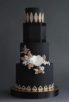 Black wedding cake with gold appliques wedding cakes cakes elegant cakes rustic cakes simple cakes unique cakes with flowers Black And White Wedding Cake, Black Wedding Cakes, Elegant Wedding Cakes, Elegant Cakes, Beautiful Wedding Cakes, Wedding Cake Designs, Beautiful Cakes, Gold Wedding, Trendy Wedding