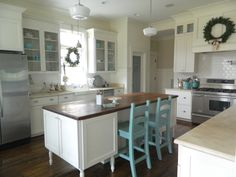 Clean white kitchen| Turquoise accents- thinking top of farm table and chairs.