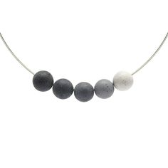 "KONZUK - To match the bracelet kmb125, this necklace features five graduated tinted concrete spheres. Each sphere is cast and finished by hand, no two neckaces will be the same. Stainless cable is available in 16"" and 18""."