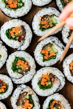 15 Crave-Worthy Vegetarian Sushi Recipes With fillings like eggplant, tofu, and sweet potatoes, vegetarian sushi is the best sushi! Here are 15 of our favorite recipes to get you rolling. Vegetarian Sushi Recipes, Sushi Roll Recipes, Veggie Sushi Rolls, Sweet Potato Sushi Roll, Homemade Sushi Rolls, Vegan Food, Sushi Vegetariano, Sushi Fillings, Lazy Cat Kitchen