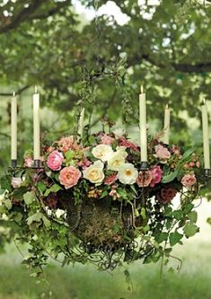 Hanging basket with candles for that perfect chandelier over our outdoor bed.