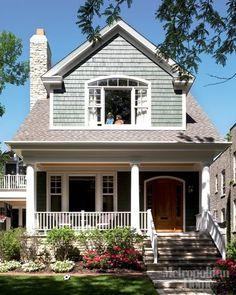Blue-gray shakes, warm wood front door.