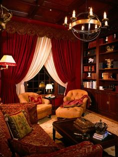 Ok, this is pretty close. Red curtains, comfy old chairs, tapestry sofa, dramatic chandelier.