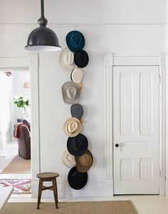 This string of wall-mounted hats caught our eye, as we're always on the lookout for clever ways to display collections. In this case, it doesn't hurt that the hats themselves are so awesome, in a beautiful range of subtle, cool colors.