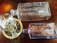 These antique Lowenstein bottles from Statesville, NC are extremely rare. We are so proud to showcase them in our distillery!