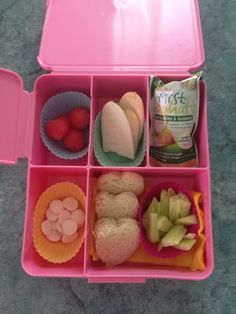 Bento box for my one year old; watermelon balls, rice crackers, pear yogurt, heart shaped sandwich, cucumber sticks and yoghurt buttons.