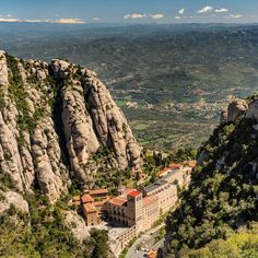 Photo by @irablockphoto// A view through the mountains of the Santa Maria Montserrat Monestary and Basilica, an hour drive from Barcelona,…
