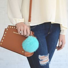 Add some personality to your keychain with this sassy and fun faux fur pom pom! We can't get enough of this chic, vibrant aqua color. Features a ring and lobster clasp closure. Treat yourself or any fabulous girl in your life to this perfect gift!