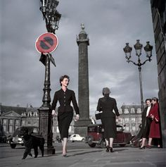 """War photographer #RobertCapa sometimes turned his lens to fashion, too. Here's a #Dior model wearing a ""New Look"" outfit in 1948. #Paris, place Vendôme.…"""