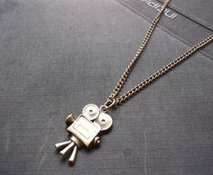 A personal favorite from my Etsy shop https://www.etsy.com/listing/105151275/old-camera-studio-vintage-necklace