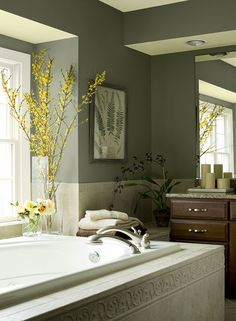 A bathroom painted in an organic green paint color. cabbage patch (green), rainforest dew (tan), hasbrouck brown (accent)